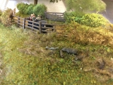 <h5>Down a country lane</h5><p>this view shows the different textures, hanging basket liner for the rough grass, Rubberised horsehair for the hedges all treated with varying grades of scatter materials. Wild animals were from Langley Models and the car was from an ABS kit.</p>