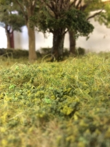 <h5>Rough grass around the Copse</h5><p>Again the rough grass was created by using hanging basket liner and the differing textures were created using various grades of scatter materials.</p>